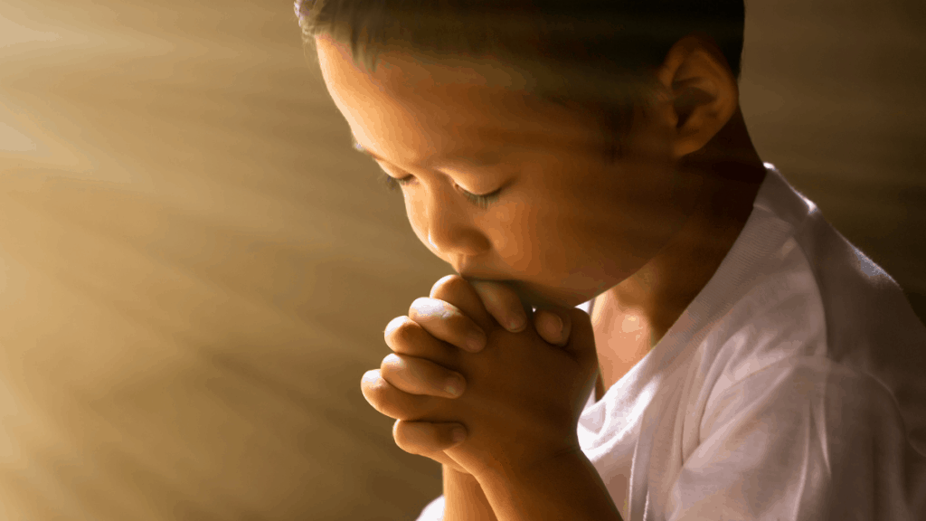 A boy praying for his nation.